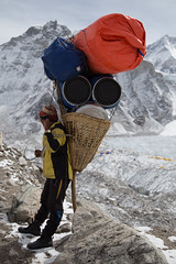 Sherpa descending from Everest stops to admire the view (nigelharris2) Tags: mountains sherpa travelling travel everestbasecamp himalayas nepal trekking canon eos 6d tourism beautiful everest basecamp landscape portrait