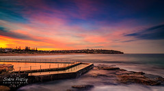 Sunset At Curl Curl Beach (Simon Pratley) Tags: australia beach canon clouds coast costa curlcurl dusk evening landscape leefilters longexposure northernbeaches nubes ocean outdoor picina playa pool reflections rocks seascape sky sunset surf sydney urbanscape water wave waves lacosta