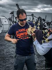 The Pipe Fixer (FotoFling Scotland) Tags: 2016 bridgeofallan bridgeofallanhighlandgames event scotland bagpipe fixer jeans male shades