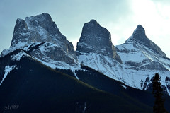 Three Sisters of Canmore, Alberta (~ Mariana ~) Tags: ab canada canmore banff rockymountains sky landscape nature snow outstandingromanianphotographers marculescueugendreamsoflightportal friends nikon travelsofhomerodyssey mariana ~mariana~