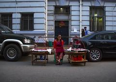 Woman Selling Food Between Two Luxury Cars In The Street,  Yangon, Myanmar (Eric Lafforgue) Tags: poverty street travel people food tourism horizontal contrast asian photography asia day yangon burma citylife stall bamboo myanmar vendor trade burmese foodanddrink developingcountry wealth rangoon foodstuff 3people birmanie threepeople traveldestinations rangon ミャンマー birmania mianmar 缅甸 בורמה 緬甸 미얀마 barma ethnicgroup ビルマ mianmá พม่า 버마 μυανμάρ мьянма βιρμανία birmanya бурма мианмар мјанмар mjanmar mjanmarsko биpмa yangonregion burma0965
