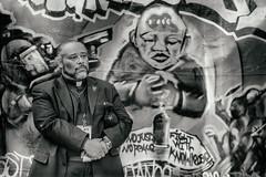 Oakland (Thomas Hawk) Tags: california eastbay johannesmehserle mehserle mehserleverdictprotest110510 oakland oscargrant usa unitedstates unitedstatesofamerica bw graffiti gun minister paster preacher protest riot riots streetart