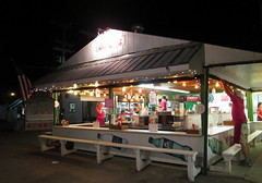 Jo-Jo's Food Stand. (dccradio) Tags: malone ny newyork franklincounty franklincountyfair communityevent fun entertainment event annual fair festival countyfair night lights jojos pizza subs burgers hotdogs benches foodstand fairfood
