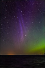 Aurora (Jonas Thomn) Tags: aurora auroraborealis norrsken purple lila revontulet foxfire sea hav havet natt night seascape stars stjrnor vatten water