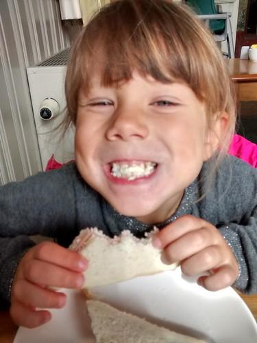 Eating a ham sandwitch