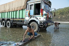 TRUCKING IN KATHMANDU (Claude  BARUTEL) Tags: city nepal mountains truck river asia capital transport cleaning clothes pollution driver kathmandu trafficjam washing trucking chaotic