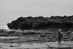 DSC_0240 (ImZakAston) Tags: sea people blackandwhite white black beach scale water girl rock stone wales out grey coast seaside sand rocks day waves sister stones gray grayscale greyscale porthcawl restbay
