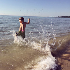(Ryan Dickey) Tags: summer vacation wisconsin swimming michael running lakemichigan splash sheboygan coldwater blueharbor lakegreatlakes michaelcanswim