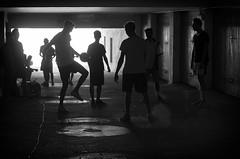 Street Boy (Federico Bottarelli) Tags: street blackwhite black white light sunlight boy football sharp pentax k50 50mm 5014