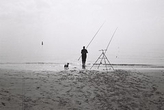 ANALOG WORLD (Georgie Pauwels) Tags: analog analogphotography public ilford film rollei sea beach dog fishing minimal