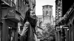 Dream of happiness (Go-tea) Tags: canon eos 100d 50mm street urban city toulouse france languedocroussillonmidipyrn languedocroussillonmidipyrnes fr model portrait outside outdoor church people young woman asian chinese bnw bw black blackwhite white stand smile dream curl tower