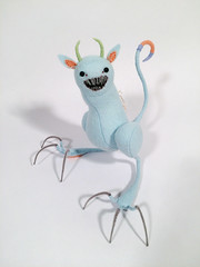 Tootsie Monster (MelissaSueArt) Tags: tootsiemonster softsculpture fauxtaxidermy designertoy arttoy plush handmade stitched embroidery monster creature demon claws teeth pastel blue robinsegg fairytale nightmare creepycute