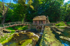 Forever Fairytale (kirstenscamera) Tags: bridge blue trees roof sky house color green mill nature water fairytale creek river outdoors waterfall pond nikon stream dam secret air cottage glen hidden reality thatch serene thatchedroof moat waterwheel littlehouse thatchroof