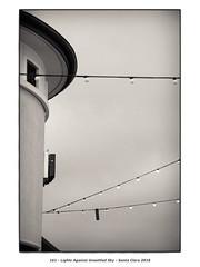 Lights Against Unsettled Sky (Godfrey DiGiorgi) Tags: bw detail lights neighborhood stilllife urban walk santaclara california usa us