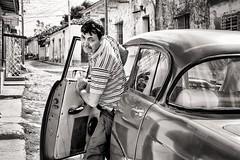 coming home (Gerard Koopen) Tags: cuba trinidad bw blackandwhite man car oldamericancar classiccar straatfotografie streetphotography straat street candid cominghome fujifilm fuji xpro1 35mm 2016 gerardkoopen brilliant