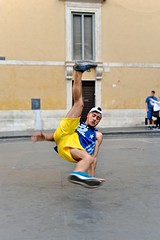 The flare (jeremyhughes) Tags: rome street city performer performance flare flares breakdancing breakdancer popping locking poppingandlocking urban shorts yellow adidas vest singlet tanktop sneakers hat motion movement action active man nikon d750 50mm 50mmf14dghsmart dance dancer streetdance streetdancer