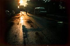 Not real yet (Melissa Maples) Tags: antalya turkey trkiye asia  apple iphone iphone6 cameraphone reflection dawn sunrise morning road bicycle cyclist black rain wet water sunny sun silhouette
