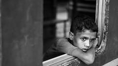 Reverie (haqiqimeraat) Tags: reverie 50mmf18 monochrome blackwhite child bw nikon bangladesh portraiture portrait boy
