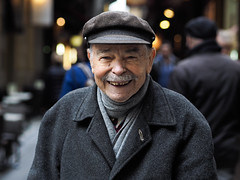 George's smile (Peter Grifoni) Tags: peter grifoni gtpete gtpete63 the human family group street stranger portrait portraiture olympus omd em1 zuiko 45mm f18 melbourne city centre lane greek george hat moustache