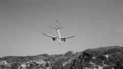 the manoeuvre (vfrgk) Tags: blackandwhite bw monochrome airplane airport cliffs lookingup lookup landing manoeuvre