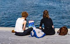 Afternoon Breakfast (Jori Samonen) Tags: people women sitting eating corn flakes milk bag pier water halkolaituri kruununhaka helsinki finland rucksack cornflakes
