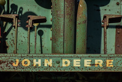 John Deere (tim.perdue) Tags: ohio state fair 2016 summer exposition center columbus street candid colorful multicolored midway carnival john deere tractor farm machinery combine old vintage antique rusty equipment implement green paint pedals rust closeup detail