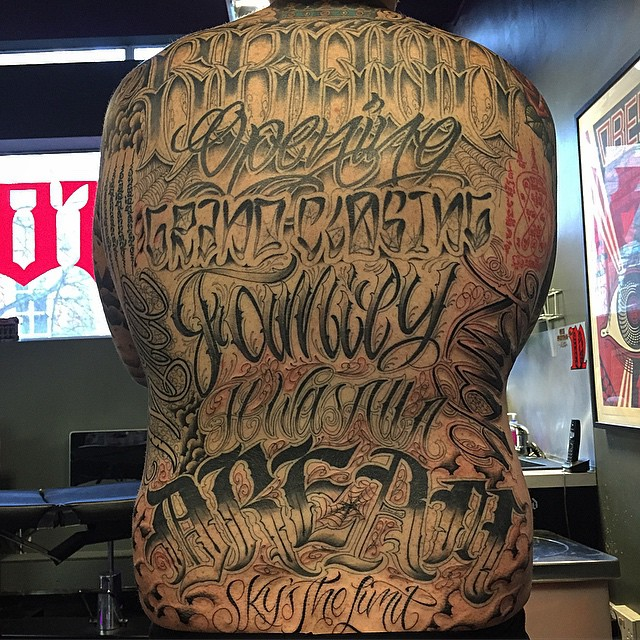 just finished up on this full back piece of script on a good friend will aka dj tango. i started the top of this just over 4 years ago when i first started tattooing and over the last few months have added the bottom half. its not often i look back at m