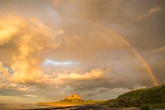 Bamburgh Rainbow (aljones27) Tags: light cloud castle history beach weather clouds golden evening coast rainbow historic northumberland coastal northumbria bamburgh goldenhour bamburgcastle