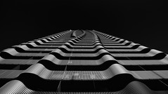Viennese Waves #2 (philippruemmele.com) Tags: sky ciy street bw black white light europe waves urban architecture summer building creative austria skyscraper modern unique symmetry structure contrasts pov 3d living residential photography fascade beautiful