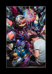 On-line balloon seller. (tkimages2011) Tags: balloon seller phone iphone colour stratford avon
