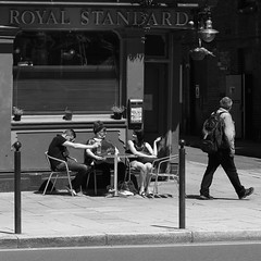 beer garden (Andrew Malbon) Tags: sigma sigmadp3 dp3 dp3m merrill foveon fixedlens fixedfocallength 50mmf28 50mm graduation portsmouth southsea hampshire streetphotography street guildhall universityofportsmouth summer beer beergarden drinking walking bw blackwhite chairs