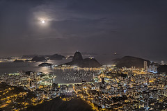 Rio under Super Moon (Daniel Schwabe) Tags: night moon bay sugarloaf tourism travel riodejaneiro water ocean cityscape lightsmountains brasil brazil