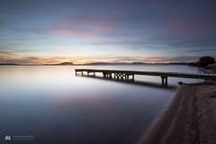 Waikuta Sunrise (nzhodgeman) Tags: sunrise lake rotorua newzealand lakerotorua jetty wharf pier dawn color colors pink longexposure smooth smoothwater sand beach lakeside clouds cloudscape