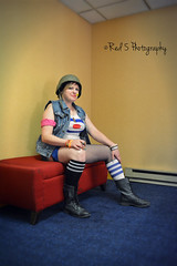 Tank Girl (Red 5 Photography) Tags: blue red orange woman white black cute sexy girl hat yellow bench colorado punk pretty legs boots cosplay candid grunge helmet gritty hallway convention blonde coloradosprings tanktop shorthair vest popculture blondehair comiccon tankgirl combatboots tubesocks 2015 sittingpose cultmovies seatedpose conventionphotography cosplaygirls cosplayphotography cosmiccon girlsofcosplay coloradocosmiccon fantasticorpscosplay fantasticorps