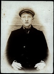 Frank Bourke, brass founder, arrested for breaking and entering and stealing food (Tyne & Wear Archives & Museums) Tags: beach cornwall lemonade criminal crime cap mugshot biscuits toffee tynemouth policestation arrested prisoner longsands northshields imprisoned breakingandentering stealingfood brassfounder