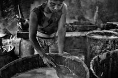 Scraping The Vat (alisdair jones) Tags: man indonesia java beans factory tofu soy yogyakarta tempeh vats ef35mmf14lusm