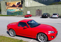 Mazda Miata NA and NC (D70) Tags: red canada art sports car festival wall by nc mural artist bc wind we na want sound topless thom local chilli mazda miata legacy squamish 1990 inaugural roadster the 2014 drher 197lgd