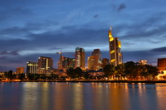 Frankfurt skyline (Mettwoosch) Tags: city longexposure trip travel sky water skyline architecture night clouds canon reflections river germany lens deutschland eos lights wasser nacht outdoor frankfurt main himmel wolken wideangle stadt architektur bluehour ufer fluss lichter langzeitbelichtung blauestunde weitwinkel spiegelungen 5dm3