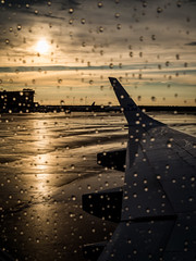 Ready to leave ... (martina.stang) Tags: airport plane sunset rain raindrops airplanewing leaving waiting hcs reflection sad emotion emotional farewell tears berdenwolken reinhardmay musiclink