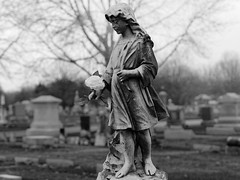 Girl of the Grave (JY_Photos) Tags: olympus microfourthirds mft micro43 dxooptics jyphotos indiana usa monochrome blackandwhite bw mzuiko45mmf18 outdoor flower cemetery tree fog girl grave olympusomdem10 mirrorless resthavencemetery edinburgh