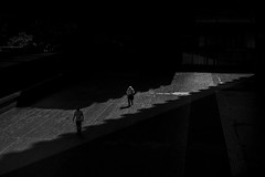 Strip of  light (At the Speed of Life) Tags: street city light shadow people blackandwhite london monochrome contrast shadows streetphotography naturallight shape eastlondon