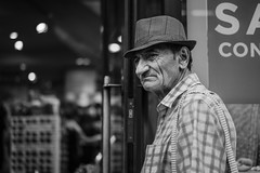 What i've seen through these eyes... (At the Speed of Life) Tags: man street streetphotography london bw blackandwhite oldman tired portrait hat streetportrait