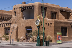 Santa Fe Square Clock (Patrick Gregerson) Tags: 2009 canon7d canonefs18200mmf3556is canonrebelxti march newmexico newmexicomuseumofart santafe architecture buildings clearskies clock cold noon people sign street sunny