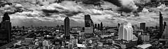 A view over Bangkok (wianphoto) Tags: olympusomdem5markii houses asia omdem5markii cloudy image clouds summer bangkok olympusmzuiko1240mm skyscrapers olympuspro1240mm sky omdem5mark2 panaorama blackandwhite wianphoto thailand