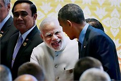 East Asia summit Vientiane: PM Narendra Modi and US President Barack Obama greet each other during the group photo session at the 11th East Asia summit. (legend_news) Tags: east asia summit vientiane pm narendra modi us president barack obama greet each other during group photo session 11th