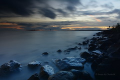 LoughNeaghSunsetSept2016-1 (CharlesM-2) Tags: charlesm charlesm2 shadowpm2 northernireland countyantrim nikon d7100 tokina 1116mm ireland uk unitedkingdom water sky clouds longexposure loughneagh lake rocks smoke sunset sun september 2016