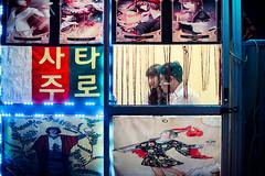 Itaewon Fortune Teller (Jon Siegel) Tags: nikon nikkor d810 50mm 12 nikon50mmf12 couple boy girl man woman boyfriend girlfriend fortuneteller fortune mysterious strange night evening itaewon korean korea seoul southkorea people