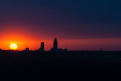 setting sun silhouette - omaha, ne (laughlinc) Tags: construction fairmountpark laughlinc lightroom lightroom5 nebraska nikond80 omaha silhouette skyline sunset nikon