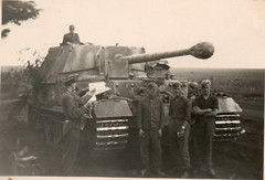 Original photo of a Ferdinand tank destroyer with camouflage and crew.