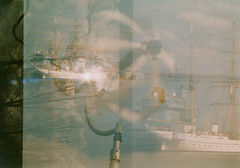IV Shots passing four coastline Spots (Rasputin AK-47) Tags: ocean blue reflection tree slr art film analog 35mm canon meer wind ae1 doubleexposure kunst balticsea multipleexposure analogue blau canonae1 breeze ostsee baum kiel warship ak47 sailingship reflektion fd tolstoy warandpeace warmachine briese bullauge tolstoi doppelbelichtung kriegsschiff filmisnotdead  photography mehrfachbelichtung kriegundfrieden be film doublelighting  tokinaatx35200mm35f
